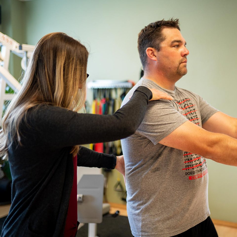 Amy Messer works with a patient at Catalyst PT