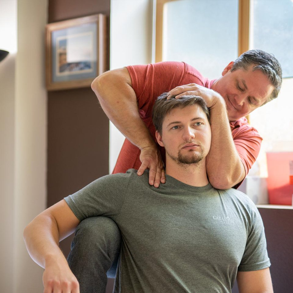 Caleb Kemp works with a Patient at Catalyst Physical Therapy in Hamilton Montana