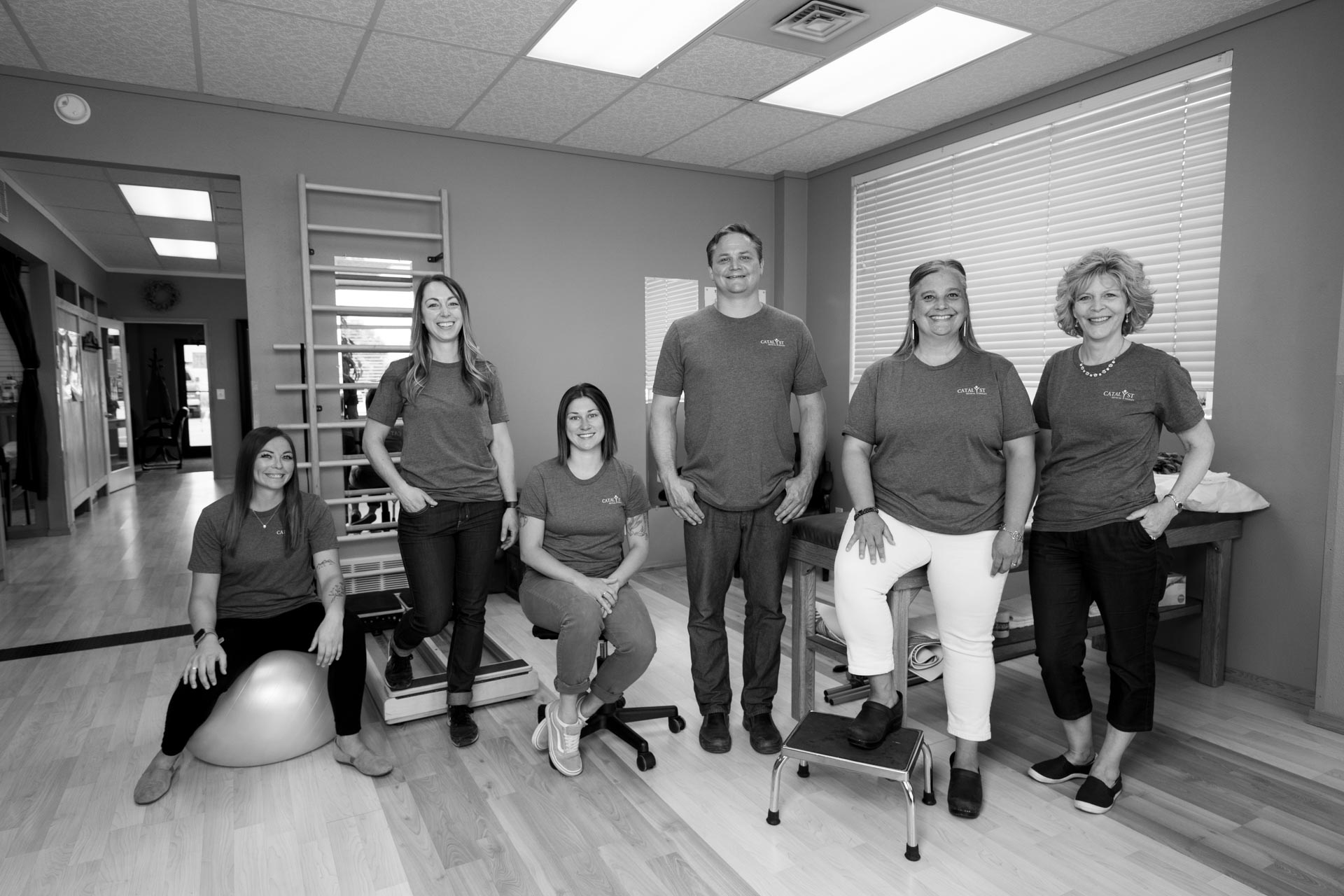 Catalyst PT Team indoors at the clinic in Hamilton MT next to the Creamery Building